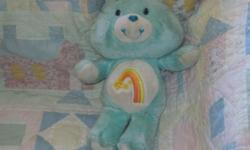 *~*This is a Sweet Little wish Carebear. It has been gently Loved and will need a light cleaning.. His nose is scuffed up. Eyeslook GoodSweet Guy hard to Find He measures about 14 inches tall. He is from a smoke free home .*~* YOU CAN CALL OR EMAIL