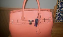 Selling this JUSTFAB woman's handbag...new...tags are still on. call 330-0067 any day except Sunday