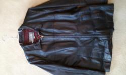 Women's Black Leather Fitted Jacket made by Wilson's Leather Color: Black Size: XL in Women's Liner: Burgundy Liner: Thinsulate - keeps you warm. Condition of Jacket: Looks New Purchased: Bought it at the Grand Traverse Mall at Wilsons Leather - which is
