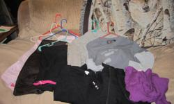 i have two large bags of womans clothes.pants size 7-8 and shirts med and large. in good condition.can just make me an offer for them.the picture is of a few of them.