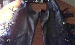 Nice womens leather chaps and vest set... made by ONDIE TOWNE USA size medium...vest has studded snaps and simulated snake skin on the lapels...chaps have zippered sides,studs and leather fringes down the legs..( never worne)