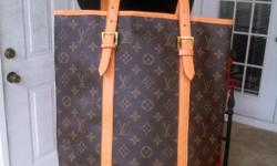 I have a Louis Vuitton Bucket Style Handbag. Has leather trim. Asking $75