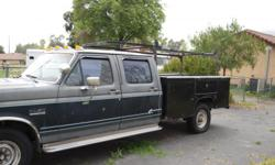 Heavy duty bed w/ locking compartments, rack, wench, spot lights, Rebuilt engine only 50k miles 2 diesel tanks. Runs great!