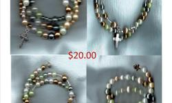 """This elegant bracelet is handcrafted with assorted beads, spacer beads, sterling silver wire as well as a cross and end charm. The complete rosary """"wraps"""" around your arm approximately two and a half times. (It's oval shape 3 inches wide X 2.25"""