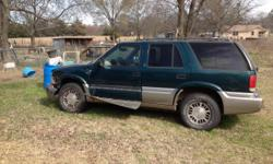 1998 GMC Jimmy for sale for parts or it can be fixed the left front wheel got bent in the wreck. It still runs and transmission ok and rear end too. Inside is clean except driver side floor gets wet when it rains. Call me for more information