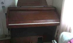 """Free to a good home! Beautiful Wurlitzer organ; cherrywoood cabinet with roll top lid. Double deck; many sounds and accompaniment;including""""one finger"""" chord; with foot pedals. Dimensions are: 46' long, 40"""" high, 25"""" deep. I cannot get it to"""