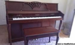 This is a Wurlitzer spinet piano and matching bench, purchased new in 1997 by my now ex-husband. It is a casualty of war - I ended up with it after the divorce. I can't stand to look at it anymore, just reminds me of the $#@&*!. So my grief is your