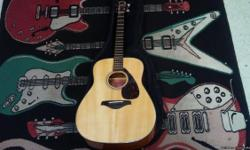 This acoustic guitar is from Yamaha, the FG700S. It plays well, the sound resonating loudly from the shell. In a public performance it will perform wonderfully. The Model FG700S has an all-American acoustic look, and this one is only slightly used, with