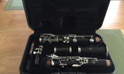 Black Yamaha Wood Clarinet with gray hard shell case. This unit has been fully maintained and serviced by Gadsden Music Company. It is was last  serviced on 5/29/2015 after its LAST use. Maintenance records are available for inspection. This