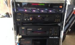 USED RETAIL $1200! From the top down: 1. SKB 10 SPACE RACK 2. JUICE GOOSE RACK POWER 200 POWER CONDITIONER 3. VOCOPRO UH5800 4 CHANNEL WIRELESS MIC RECEIVER/W MICS! 4.API KAROKE DVD PLAYER 5.LITTLELYTE: RACK MOUNT LIGHT BARS 6.CAVS JB99 3 DISC KARAOKE