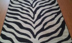 Awesome like new zebra throw rug!! 5 feet by 3 feet 9 inches. No stains.  $40 OBO, cash only, you pick up!!